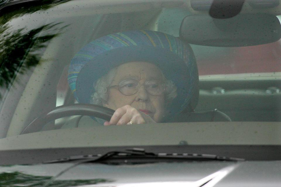 <p>Almost hidden behind the steering wheel, Queen Elizabeth drove her Jaguar to the Credit Suisse Royal Windsor Cup Final at Guards Polo Club. </p>