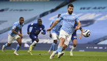 Manchester City's Sergio Aguero shoots a penalty kick during the English Premier League soccer match between Manchester City and Chelsea at the Etihad Stadium in Manchester, Saturday, May 8, 2021.(Shaun Botterill /Pool via AP)