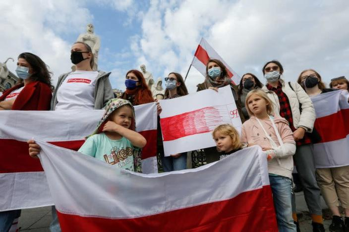 Demonstrators attend a rally in solidarity with Belarusian opposition in Kyiv