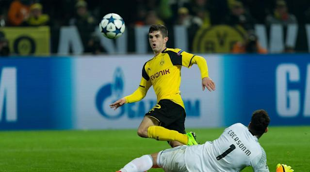 <p>Christian Pulisic chips the goalkeeper in scoring a massive goal for Dortmund in its triumph over Benfica in the 2016-17 Champions League round of 16.</p>