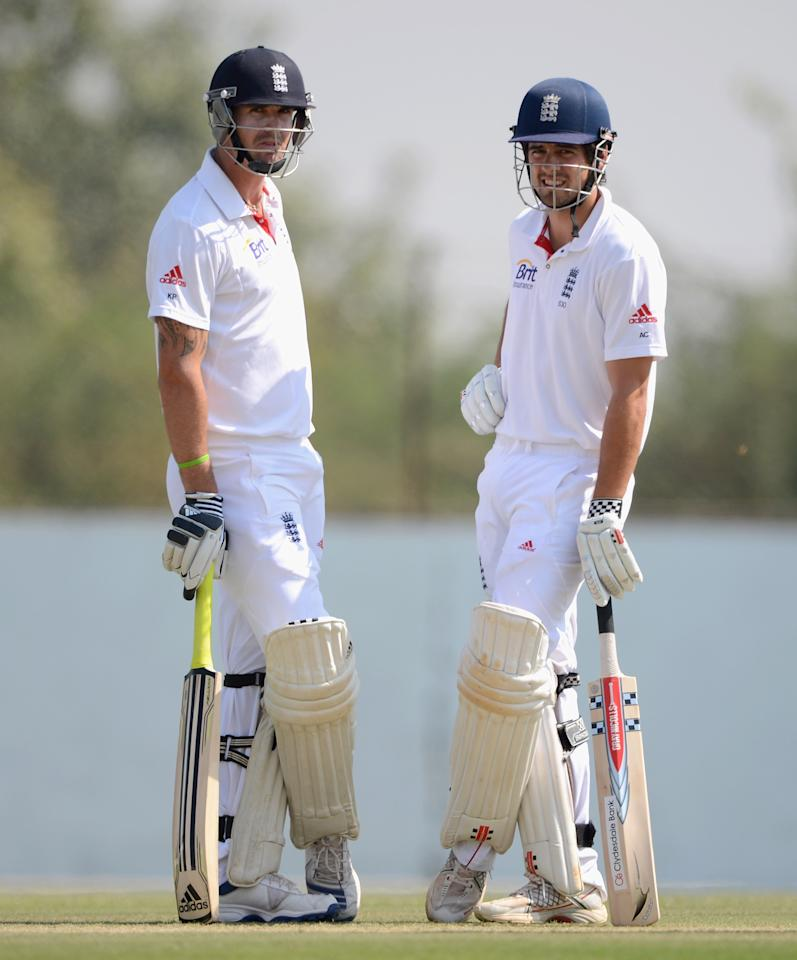 AHMEDABAD, INDIA - NOVEMBER 11:  England captain Alastair Cook and Kevin Pietersen during day four of the tour match between England and Haryana at Sardar Patel Stadium ground B on November 11, 2012 in Ahmedabad, India.  (Photo by Gareth Copley/Getty Images)
