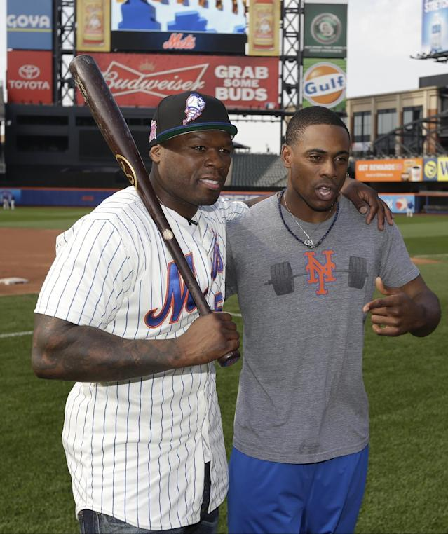 Raper 50 Cent poses for photographs with New York Mets' Curtis Granderson before a baseball game against the Pittsburgh Pirates on Tuesday, May 27, 2014, in New York. (AP Photo/Frank Franklin)