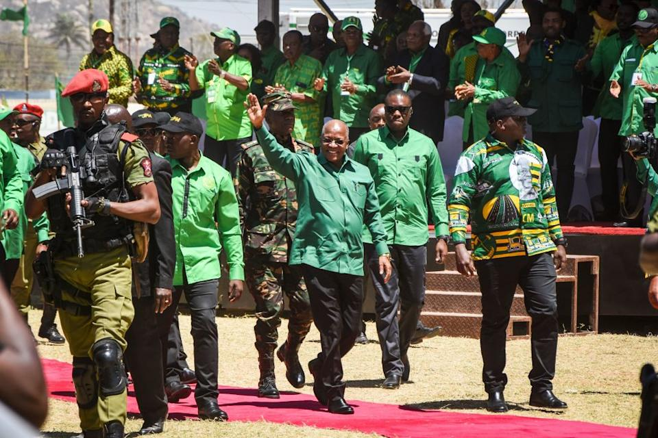 Tanzania's incumbent President and presidential candidate of ruling party Chama Cha Mapinduzi (CCM) John Magufuli (C) waves as he arrives to give a speech during the official launch of the party's campaign for the October general election at the Jamhuri stadium in Dodoma, Tanzania.