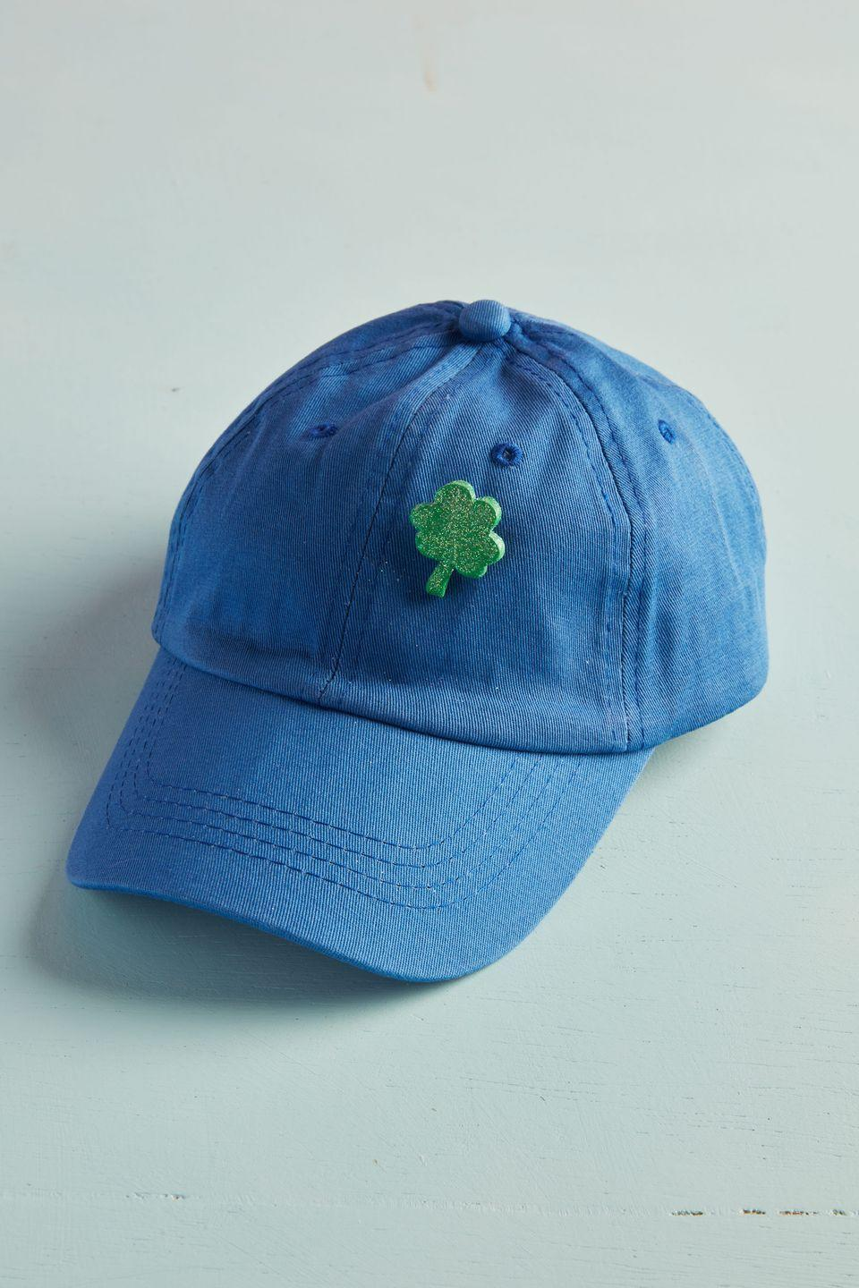 """<p>Proudly display your Irish pride with this DIY clover pin. <br><strong><br>To make:</strong> Roll out <a href=""""https://www.michaels.com/2oz-sculpey-iii-oven-bake-clay/M10132638.html"""" rel=""""nofollow noopener"""" target=""""_blank"""" data-ylk=""""slk:green oven-bake clay"""" class=""""link rapid-noclick-resp"""">green oven-bake clay</a> to 3/8-inch thick. Cut out shape with a mini shamrock cookie cutter. Bake per manufacturer's instructions. When cool, brush a light layer of craft glue on the shamrock and sprinkle with <a href=""""https://www.amazon.com/Efavormart-Glitter-Shaker-Wedding-Centerpieces/dp/B07QH81LG5/ref=sr_1_2"""" rel=""""nofollow noopener"""" target=""""_blank"""" data-ylk=""""slk:green glitter"""" class=""""link rapid-noclick-resp"""">green glitter</a>. Glue a <a href=""""https://www.amazon.com/Brooch-Safety-Pieces-Silver-Badges/dp/B07R7M5MTG/ref=sr_1_1"""" rel=""""nofollow noopener"""" target=""""_blank"""" data-ylk=""""slk:brooch pin"""" class=""""link rapid-noclick-resp"""">brooch pin</a> on the back. <br></p><p><a class=""""link rapid-noclick-resp"""" href=""""https://www.amazon.com/Boao-Patricks-Shamrock-Cutters-Stainless/dp/B083PQ2X1R/ref=sr_1_8?tag=syn-yahoo-20&ascsubtag=%5Bartid%7C10050.g.4035%5Bsrc%7Cyahoo-us"""" rel=""""nofollow noopener"""" target=""""_blank"""" data-ylk=""""slk:SHOP COOKIE CUTTERS"""">SHOP COOKIE CUTTERS</a></p>"""