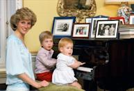 <p>We bet William and Harry took loads of piano lessons. But here, the 3-year-old and 1-year-old, respectively, just pose for a picture with their mum at Kensington Palace in October 1985.</p>