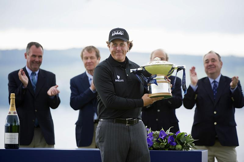 Phil Mickelson from the US, poses with the trophy, after winning the Scottish Open, at Castle Stuart Golf Course, in Inverness, Scotland, Sunday July 14, 2013. Phil Mickelson birdied the first playoff hole to beat Branden Grace and win the Scottish Open on Sunday, ending his 20-year wait for a victory in Europe. (AP Photo/PA, Kenny Smith) UNITED KINGDOM OUT