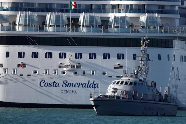 A Guardia di Finanza boat passes the Costa Smeralda cruise ship of Costa Crociere, carrying around 6,000 passengers, as it sits docked at the Italian port of Civitavecchia on Thursday. Photo: Guglielmo Mangiapane/Reuters