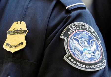 FILE PHOTO: A U.S. Customs and Border Protection arm patch and badge is seen at Los Angeles International Airport