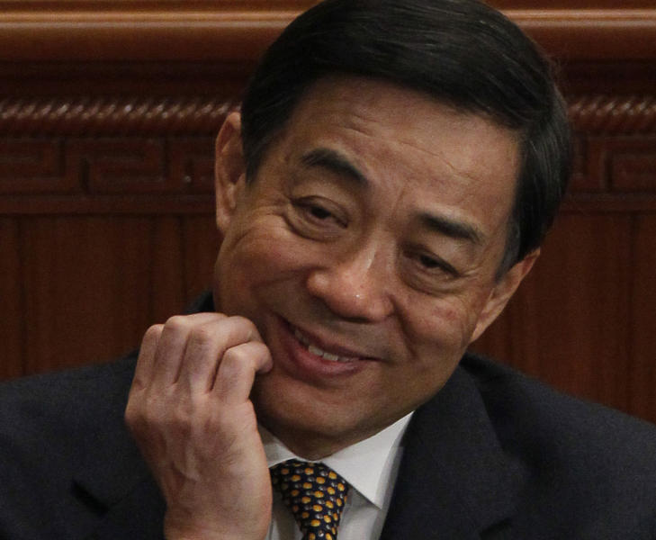 FILE - In this March 5, 2012 file photo, then Chongqing Communist Party Secretary Bo Xilai scratches his chin during the opening session of the National People's Congress in Beijing. Disgraced Chinese politician Bo Xilai was indicted Thursday, July 25, 2013, on charges of corruption, accepting bribes and abuse of power, state media reported, moving China's biggest political scandal in years toward closure. (AP Photo/Ng Han Guan, File)