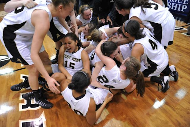 Members of the Army women's basketball team celebrate after beating Holy Cross in an NCAA college basketball game in the Patriot League Championship at Christi Arena, Saturday, March 15, 2014, at West Point, N.Y. Army won 68-58. (AP Photo/Karl Rabe)
