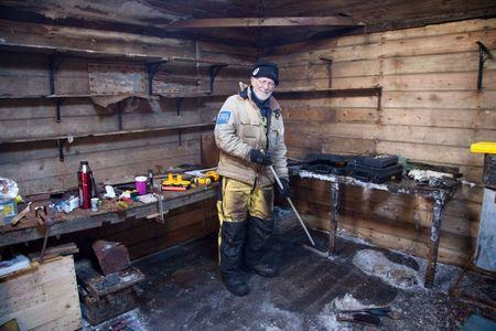 Mawson's Huts expedition conservator Peter Maxwell stands in the workshop section of Mawson's Hut at Cape Denison in Antarctica in this January 4, 2016 handout photo. REUTERS/David Killick/Mawsons Huts Foundation/Handout via Reuters