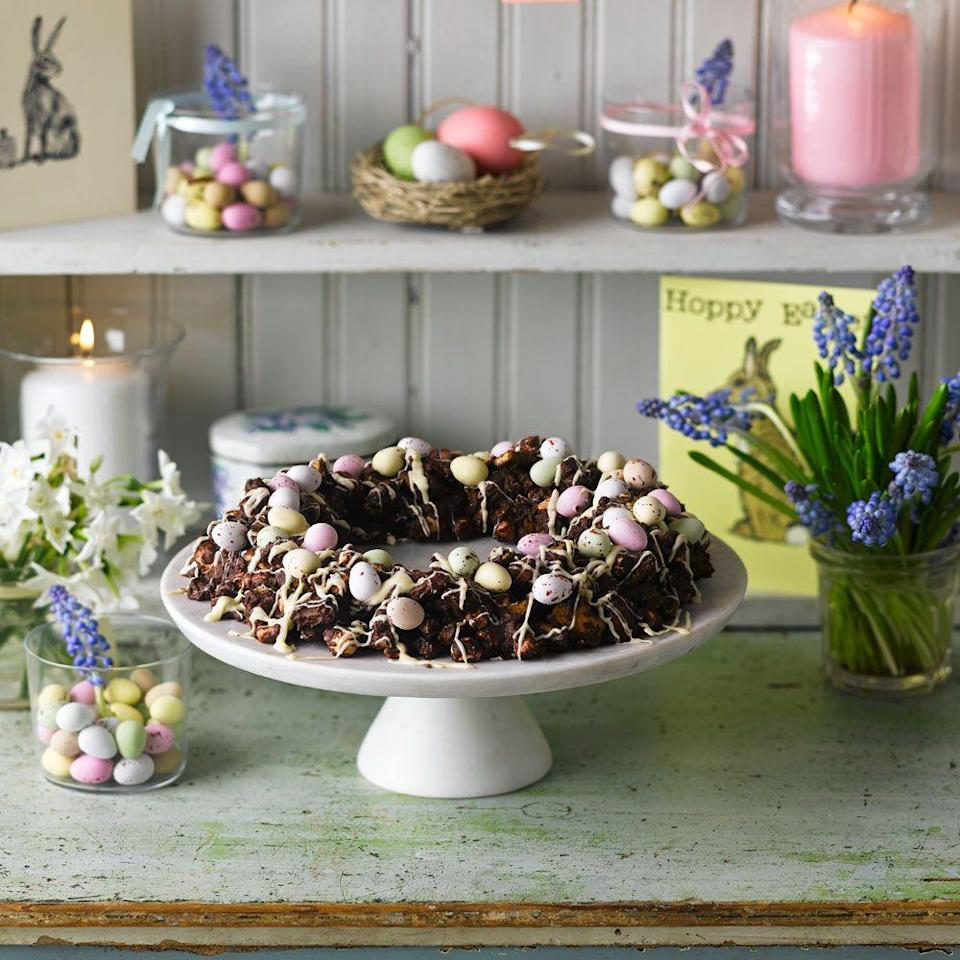 """<p>A delicious chocolate rocky road in a pretty wreath shape.</p><p><strong>Recipe: <a href=""""https://www.goodhousekeeping.com/uk/easter/easter-recipes/a559675/chocolate-easter-wreath/"""" rel=""""nofollow noopener"""" target=""""_blank"""" data-ylk=""""slk:Chocolate no-bake Easter wreath"""" class=""""link rapid-noclick-resp"""">Chocolate no-bake Easter wreath</a></strong></p>"""
