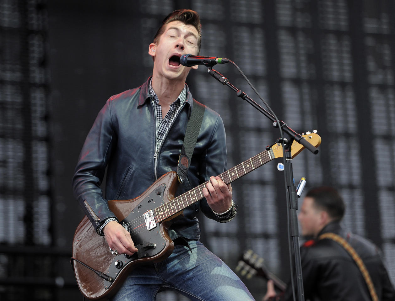 Alex Turner of British band Arctic Monkeys performs during the band's set on the first weekend of the 2012 Coachella Valley Music and Arts Festival, Friday, April 13, 2012, in Indio, Calif. (AP Photo/Chris Pizzello)