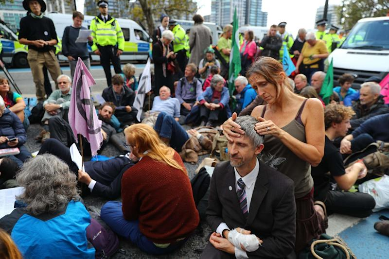 Extinction Rebellion protesters outside MI5 Headquarters on Millbank on Tuesday (PA)