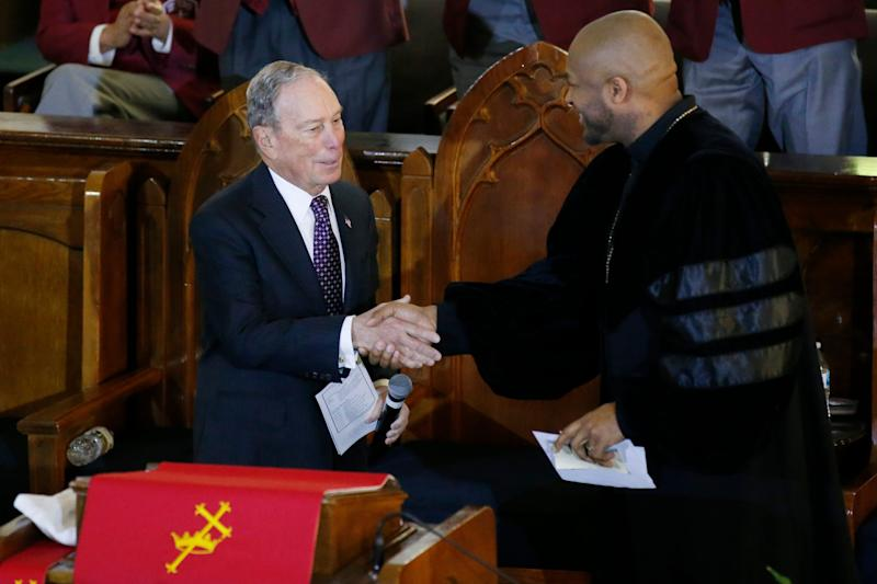Former New York Mayor Michael Bloomberg greets the Rev. Robert Turner in Tulsa, Oklahoma, on Jan. 19, 2020.