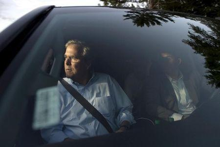 Republican presidential candidate Jeb Bush leaves following a town hall gathering at Turbocam International in Barrington