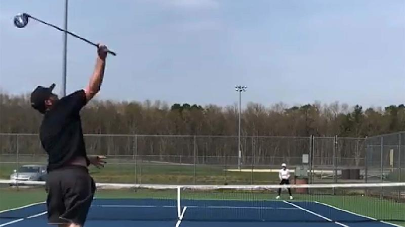 Watch: This guy is way too good at playing tennis with golf club