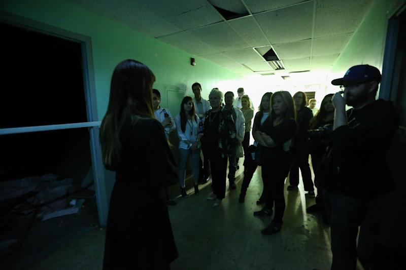 """People participate in a tour of Linda Vista Hospital at the """"American Horror Story: Asylum"""" sleepover, on Monday, Oct. 7, 2013, in Los Angeles. (Photo by Paul A. Hebert/Invision/AP)"""