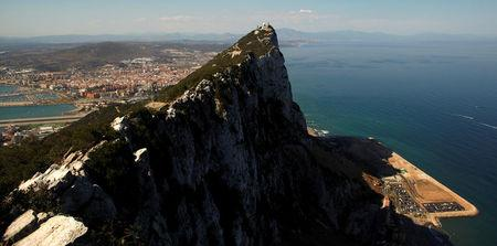 FILE PHOTO: The Spanish city of La Linea de la Concepcion and the Rock, the monolithic limestone promontory, are seen next to the construction of Cape Vantage, in the British overseas territory of Gibraltar
