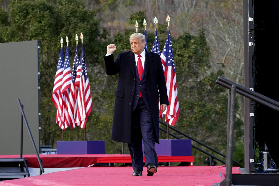 President Donald Trump leaves after speaking at a campaign rally at Keith House, Washington's Headquarters, Saturday, Oct. 31, 2020, in Newtown, Pa. (AP Photo/Alex Brandon)