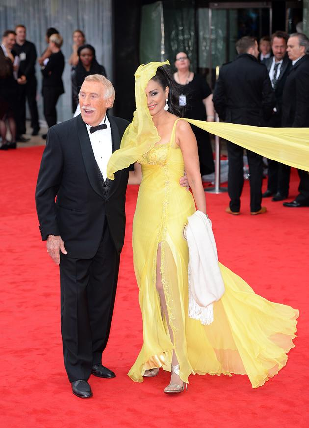 TV BAFTAS 2013 wardrobe malfunctions: Bruce Forsyth's wife Wilnelia's dress was totally out of control as the wind blew floaty swathes of material over her entire face. Copyright [PA]