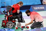 Britain's Claire Taggart checks as a referee measures the distance between balls during her match against Argentina's Luis Cristaldo in the boccia individual BC2 class (AFP/Behrouz MEHRI)