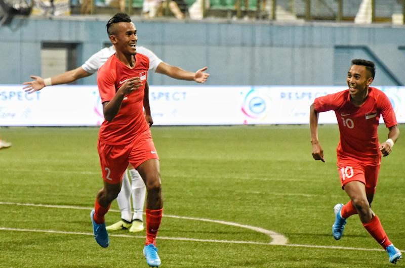 Singapore's Shakir Hamzah (left) celebrates with teammate Faris Ramli after scoring the opening goal against Palestine in their 2022 World Cup qualifying match at the Jalan Besar Stadium. (PHOTO: Football Association of Singapore)