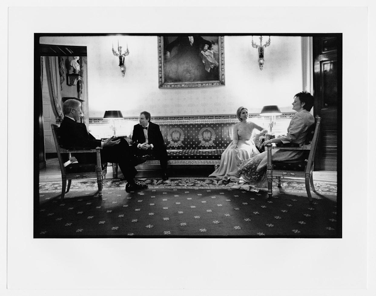 The Clintons, with British Prime Minister Tony Blair and Cherie Blair, rest after a receiving line before a state dinner. February 5,1998.