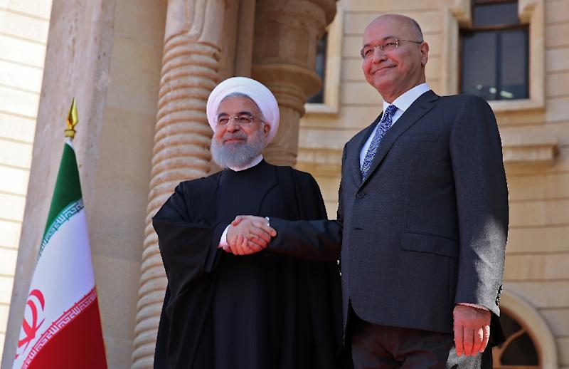 Iraqi President Barham Saleh (R) says his country must not be dragged into another conflict in the Middle East, as tensions rise over its neighbour Iran