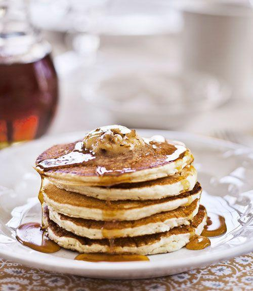 """<p>These fluffy sour-cream pancakes bear pats of maple-pecan butter and generous pours of dark-amber syrup.</p><p><strong><a href=""""https://www.countryliving.com/food-drinks/recipes/a4111/sour-cream-pancakes-maple-pecan-butter-recipe-clv0212/"""" rel=""""nofollow noopener"""" target=""""_blank"""" data-ylk=""""slk:Get the recipe"""" class=""""link rapid-noclick-resp"""">Get the recipe</a>.</strong><br></p><p><a class=""""link rapid-noclick-resp"""" href=""""https://www.amazon.com/Home-table-folding-breakfast-Bamboo/dp/B00PHS97EU/?tag=syn-yahoo-20&ascsubtag=%5Bartid%7C10050.g.1681%5Bsrc%7Cyahoo-us"""" rel=""""nofollow noopener"""" target=""""_blank"""" data-ylk=""""slk:SHOP BREAKFAST TRAYS"""">SHOP BREAKFAST TRAYS</a></p>"""