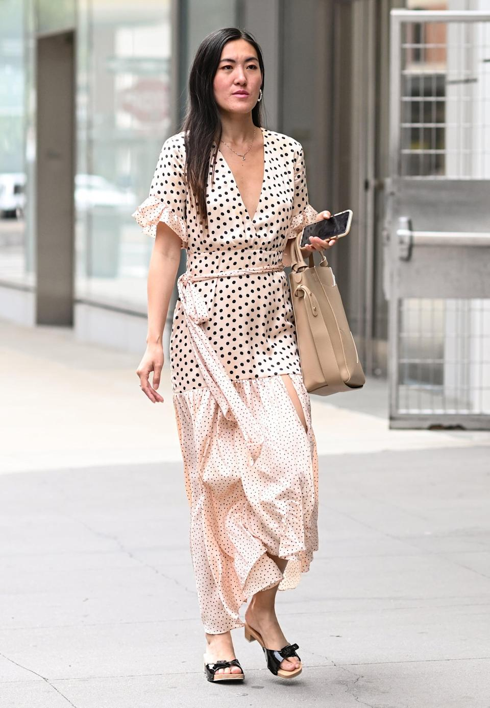 <p>Keep all eyes on the print of your maxi dress by opting for a simple tote and wooden sandal.</p>