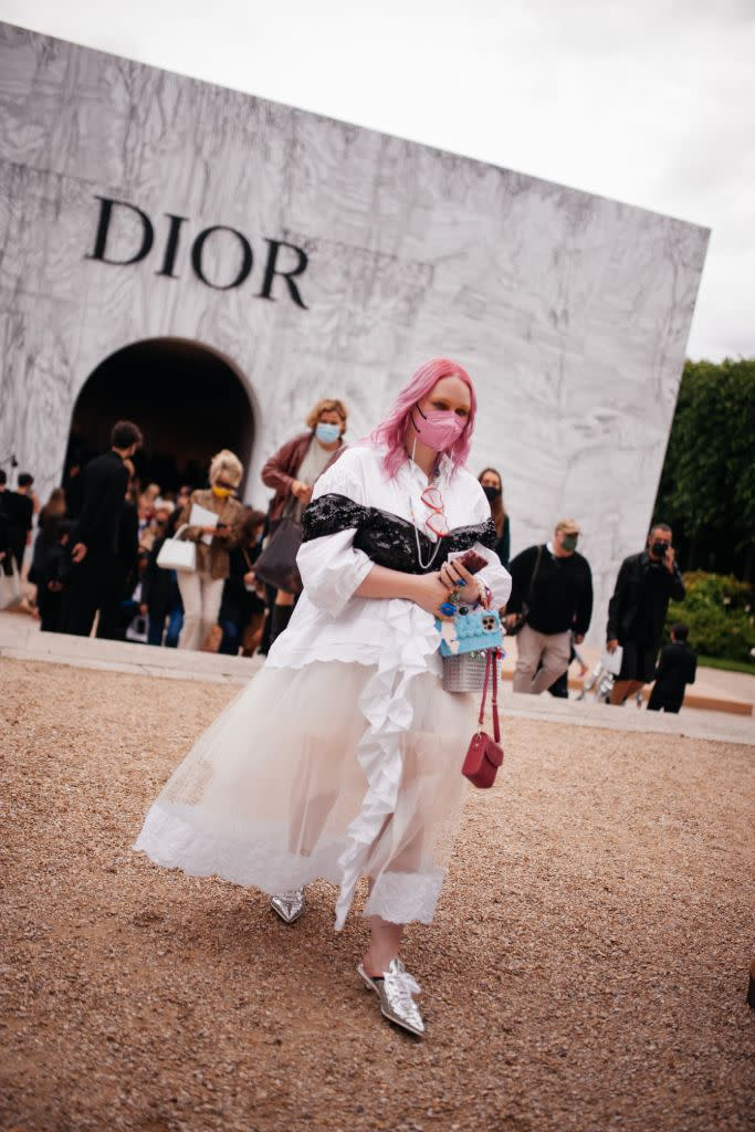 Pink hair with a matching mask at Paris Couture this summer. - Credit: WWD