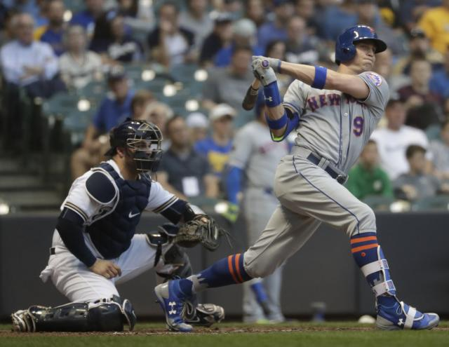 New York Mets' Brandon Nimmo hits a triple during the third inning of a baseball game against the Milwaukee Brewers Thursday, May 24, 2018, in Milwaukee. (AP Photo/Morry Gash)