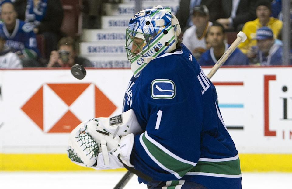 VANCOUVER, CANADA - MARCH 14: Goalie Roberto Luongo #1 of the Vancouver Canucks juggles the puck after making a save against the Phoenix Coyotes during the first period in NHL action on March 14, 2012 at Rogers Arena in Vancouver, British Columbia, Canada. (Photo by Rich Lam/Getty Images)