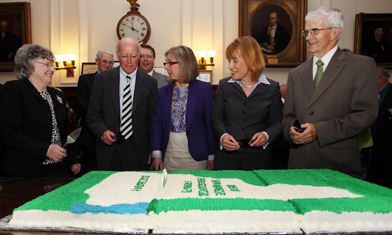 Sybil Dupuis, left, the great granddaughter of Stephen Bullock, the father of the New Hampshire primary, gets ready to cut the 100th anniversary cake with, from left,  Secretary of State Bill Gardner, Speaker of the House Terie  Norelli,  Gov. Maggie Hassan, D-N.H., and David Berry Tuesday, May 21, 2013 in Concord, N.H. (AP Photo/Jim Cole)