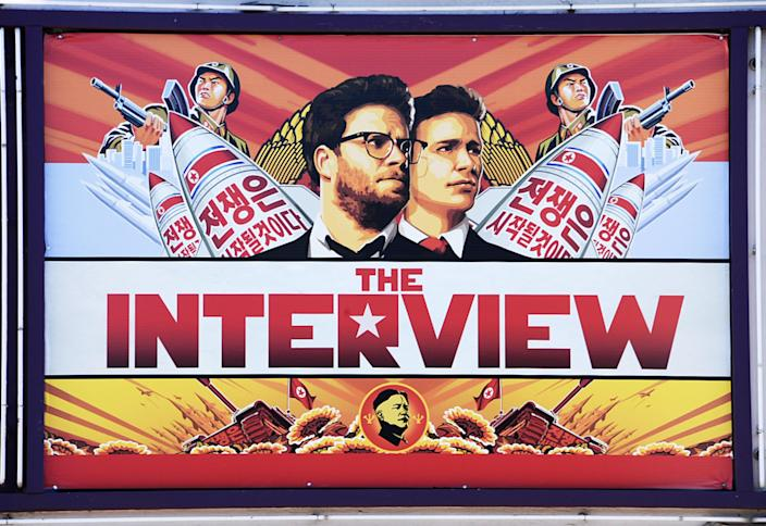 """A poster for """"The Interview"""" displayed in Los Angeles, California, on December 25, 2014 (AFP Photo/Robyn Beck)"""