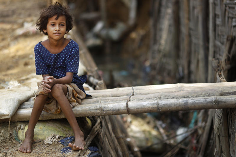 A Rohingya Muslim girl sits at an unauthorized camp that houses Rohingya Muslim refugees who fled Myanmar during an ethnic strife in 1992, at Kutupalong, Bangladesh, Wednesday, June 20, 2012. World Refugee Day, a day initiated by the United Nations to raise awareness on the plight of refugees worldwide, is observed on June 20 every year.  (AP Photo/ Saurabh Das)