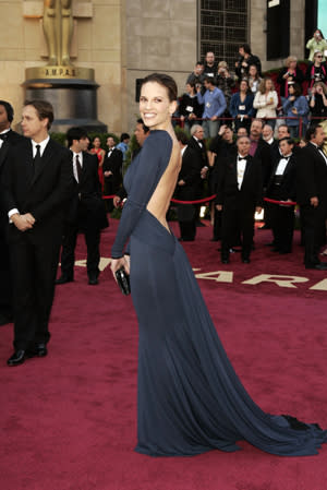 "<div class=""caption-credit""> Photo by: Fairchild Archive</div><div class=""caption-title""></div><p>   <b>Hilary Swank in a backless navy gown by Guy Laroche, 2005</b> </p> <p>   Hilary Swank won Best Actress for her work in Million Dollar Baby at the 2005 Oscars-but her chic backless dress from Paris designer Guy Laroche was about as far from the boxing ring as a look could get. </p>"