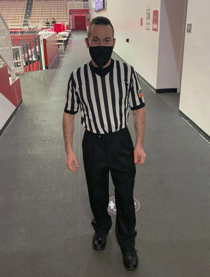 Veteran women's basketball official Joe Vaszily wearing a mask to protect against COVID-19, is photographed before refereeing a scrimmage basketball game at St. John's University in New York, on Thursday, Nov. 19, 2020. Vaszily has worked the past seven Final Fours and is ready for the new season to begin Wednesday, Nov. 25. (Jorge Martinez/Joe Vaszily via AP)