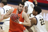 Oregon State center Roman Silva drives to the basket against California forward Andre Kelly during the first half of an NCAA college basketball game in Berkeley, Calif., Thursday, Feb. 25, 2021. (AP Photo/Jed Jacobsohn)