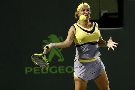 Mar 27, 2017; Miami, FL, USA; Svetlana Kuznetsova of Russia hits a forehand against Venus Williams of the United States (not pictured) on day seven of the 2017 Miami Open at Crandon Park Tennis Center. Williams won 6-3, 7-6(4). Mandatory Credit: Geoff Burke-USA TODAY Sports