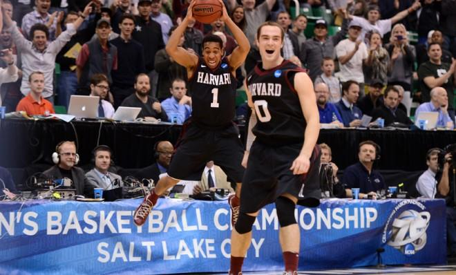 Siyani Chambers (left) and Laurent Rivard of the Harvard Crimson celebrate after beating the third-seeded New Mexico Lobos on March 21.