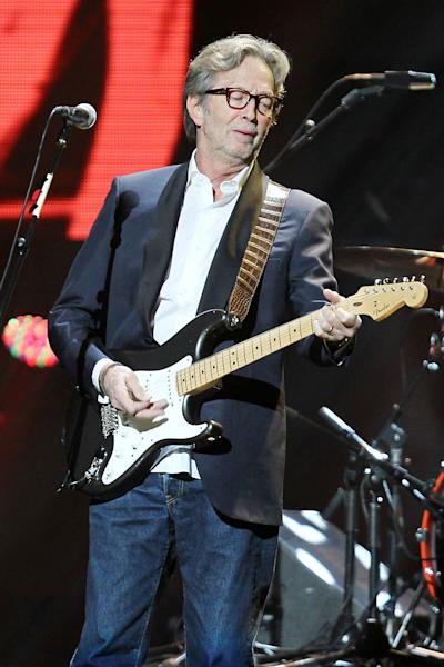 FILE- In this Dec. 12, 2012 file photo provided by Starpix, Eric Clapton performs on stage at the 12-12-12 The Concert for Sandy Relief at Madison Square Garden in New York. The over $50 million in proceeds from the show were distributed through the Robin Hood Foundation to largely small, grassroots groups on the storm-devastated New York and New Jersey coastlines. (AP Photo/Starpix, Dave Allocca, File)