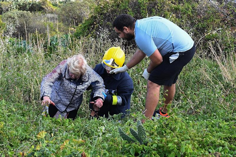 Rescue workers attended to injured passengers in the undergrowth where the bus came to a halt (AFP Photo/RUI SILVA)