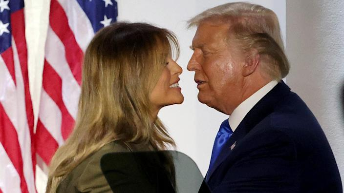 President Donald Trump and first lady Melania Trump embrace after she addressed the Republican National Convention from the Rose Garden at the White House on August 25, 2020. (Alex Wong/Getty Images)