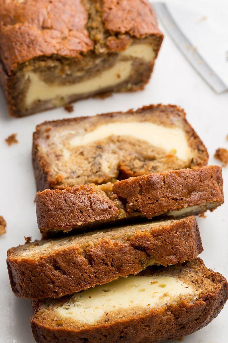 """<p>If you love cheesecake, this bread will rock your world.</p><p>Get the <a href=""""https://www.delish.com/uk/cooking/recipes/a28826443/cheesecake-stuffed-banana-bread-recipe/"""" rel=""""nofollow noopener"""" target=""""_blank"""" data-ylk=""""slk:Cheesecake Stuffed Banana Bread"""" class=""""link rapid-noclick-resp"""">Cheesecake Stuffed Banana Bread</a> recipe.</p>"""