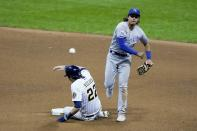 Milwaukee Brewers' Christian Yelich is out at second as Kansas City Royals' Nicky Lopez turns a double play on a ball hit by Ryan Braun during the sixth inning of a baseball game Saturday, Sept. 19, 2020, in Milwaukee. (AP Photo/Morry Gash)