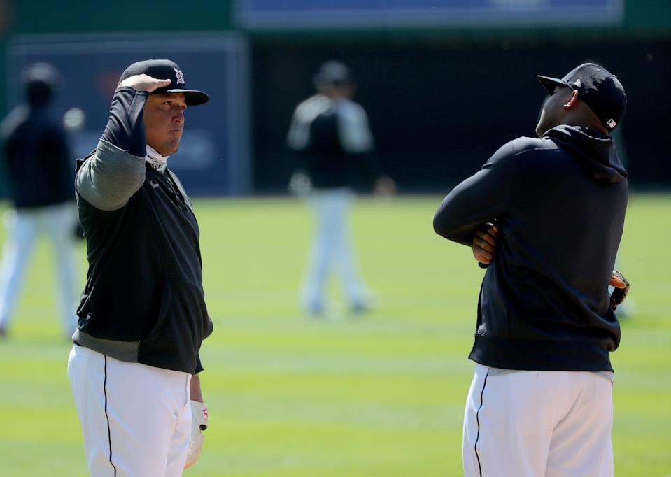Tigers first baseman Miguel Cabrera salutes second baseman Jonathan Schoop on the field during practice on Wednesday, March 31, 2021, at Comerica Park.