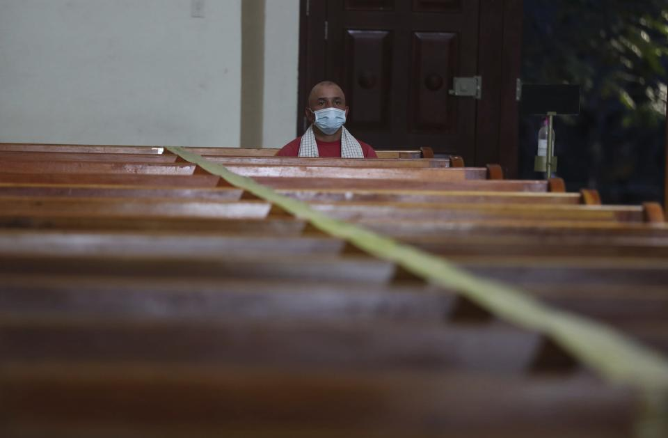 A man wearing a mask to curb the spread of the new coronavirus attends a Mass in Campohermoso, Colombia, Thursday, March 18, 2021. Campohermoso is one of two municipalities in Colombia that has not had a single case of COVID-19 since the pandemic started one year ago. (AP Photo/Fernando Vergara)