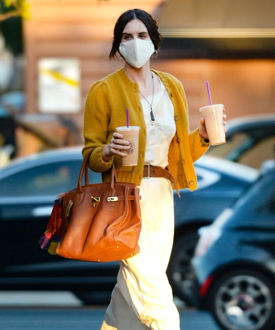 <p>Scout Willis double fists two coffees while out in L.A. on Tuesday.</p>